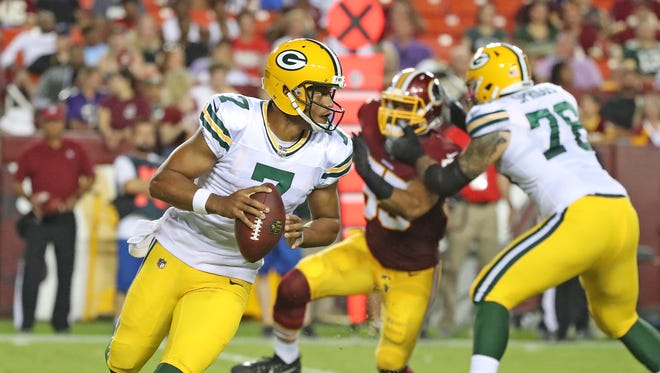 Green Bay Packers quarterback Brett Hundley (7) rolls right as tackle Jason Spriggs (78) blocks against the Washington Redskins Saturday, August 19, 2017 at Fedex Field in Landover, MD.