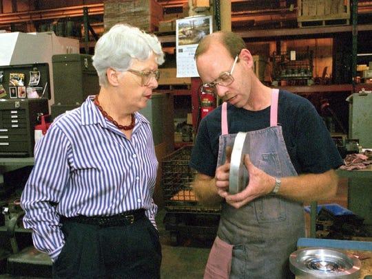 Wendall Watkins, right, shows Nelson Mooers van den