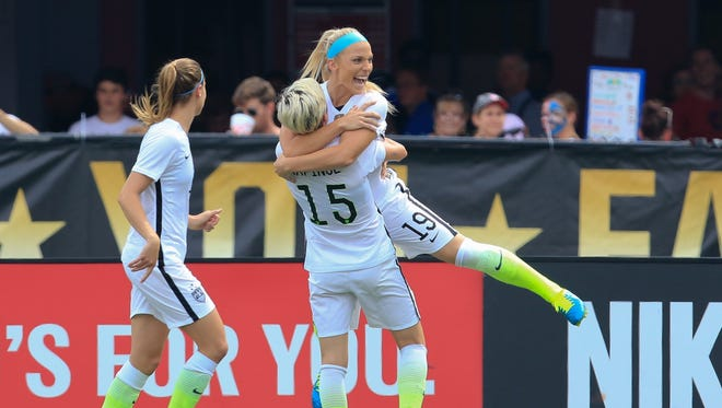United States defender Julie Johnston (19) celebrates with Megan Rapinoe (15) after Johnston scored the first goal against the Haiti team at Legion Field.