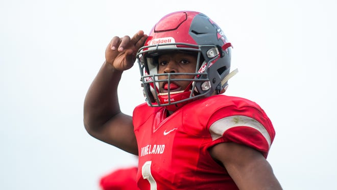 Vineland quarterback Isaih Pacheco celebrates a touchdown last season. Pacheco committed to Rutgers on Wednesday night.