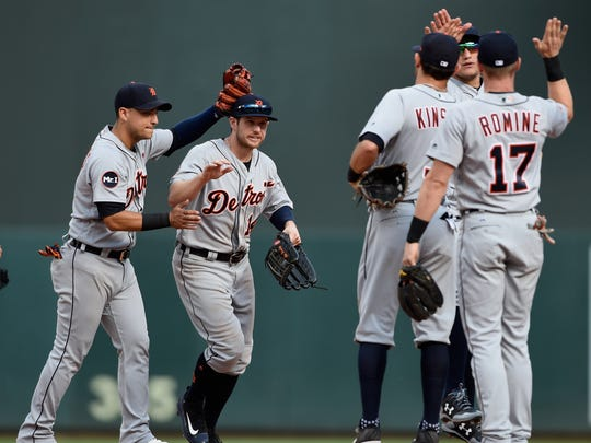 (From left) Tigers shortstop Jose Iglesias  and rightfielder