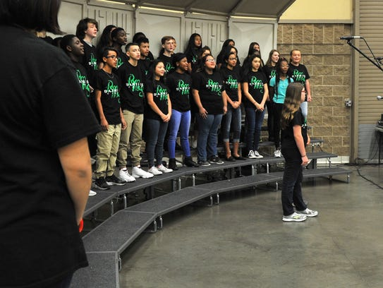 The Barwise Middle School choir performs a variety of Christmas carols for an audience gathered at the Ray Clymer Exhibit Hall Friday morning for Christmas Magic.