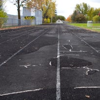 The Marshfield Middle School track, as seen in this 2013 file photo, has deteriorated to the point where the district no longer can host track meets.