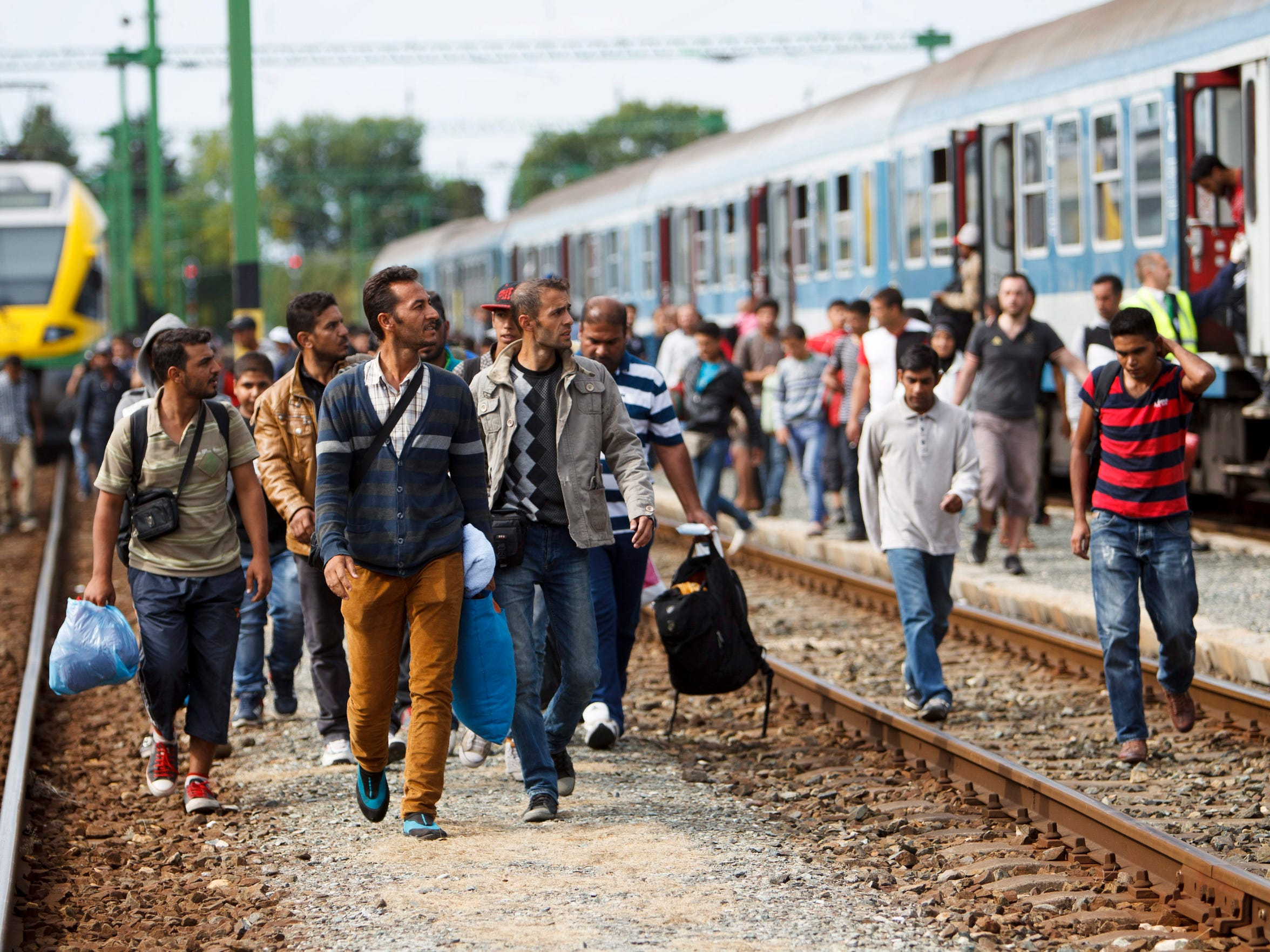 Migrants and refugees arrive at the railway station in Szentgotthard, Hungary, near the Austrian border, on Sept. 19, 2015.