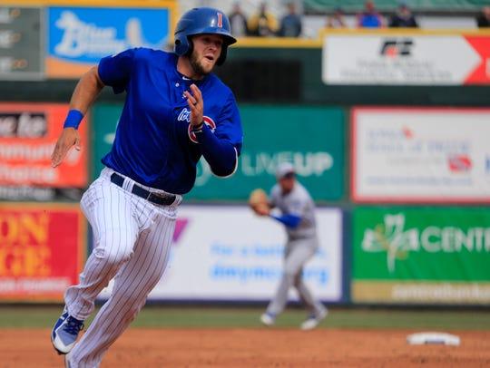 David Bote runs the bases as the Iowa Cubs open their