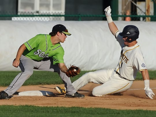 Eric Willis slides into third on a triple after driving