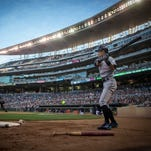 Miami Marlins' Ichiro Suzuki prepares to bat against the Minnesota Twins in the fourth inning of a baseball game Tuesday, June 7, 2016, in Minneapolis. The Minnesota Twins won 6-4 in 11 innings. (AP Photo/Bruce Kluckhohn)