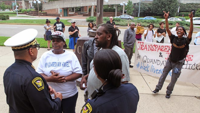 The parents of Quandavier Hicks, who was killed in a confrontation with police in June, speak with Chief Jeffrey Blackwell during a Black Lives Matter protest on Friday.