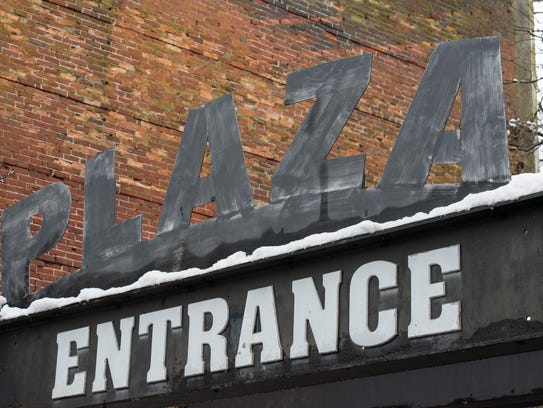 Snow piles on a sign downtown Salisbury on Friday,