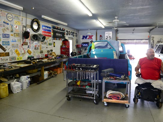 Charles Williams sits inside his Harbeson workshop