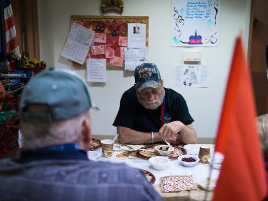 Navy veteran Greg Miller attends a holiday dinner organized