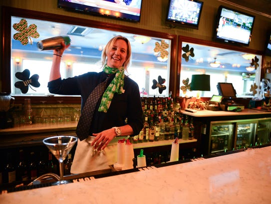 Bartender J. Bollinger makes a green martini on Friday,