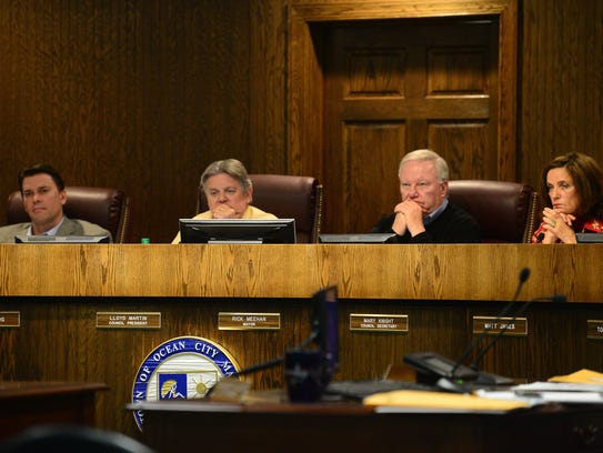 Ocean City's mayor and town council members listen