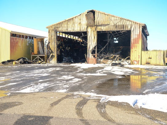 A structure fire at Dukes Lumber Yard in Laurel left