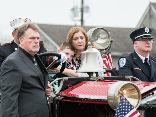 A funeral procession for Laurel firefighter Alan Schweitzer