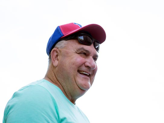 Cherry Hill Township bus driver Tom Bush laughs while