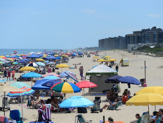 Umbrellas can be seen for miles at Bethany Beach during the holiday week on July 3, 2017.