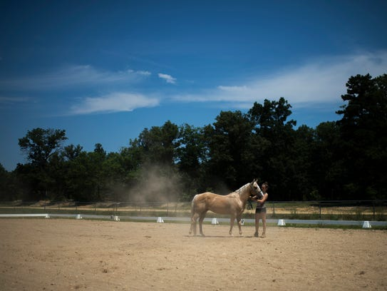Lacey'Anne Crawford, 13, exercises her horse Hot Shot