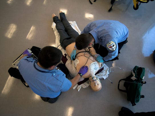 Paramedic students Frank Civitano, left, and Robert