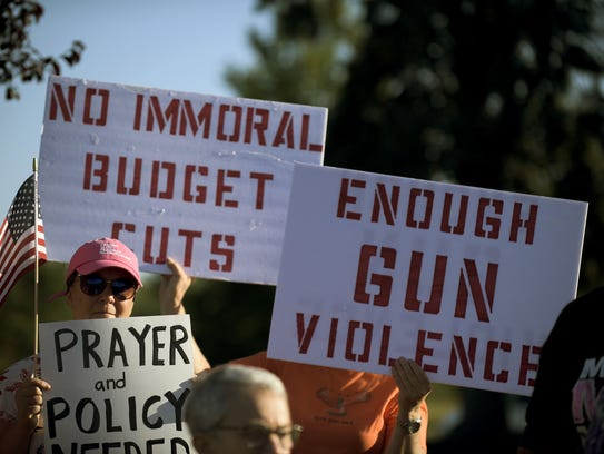 Protestors gather during a demonstration for more gun