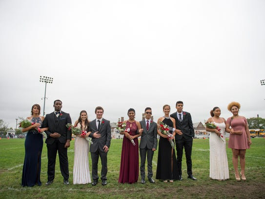 Miss Monogram contestants stand with their escorts