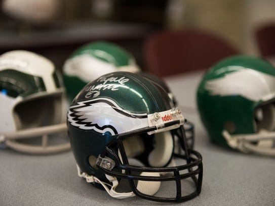A miniature Eagles helmet signed by Vince Papale is part of the auction from the Burlington County Prosecutor's Office Tuesday, Nov. 14, 2017 in Westampton.