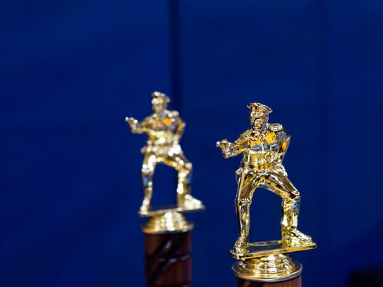 Firearms award trophies are seen on a table before