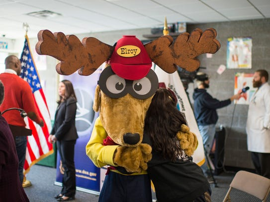 Charlene Maycott of Hammonton, right, is hugged by Elroy the Elk, following a U.S. Drug Enforcement Administration press event Tuesday at the Boys & Girls Club in Camden. The law enforcement agency is rolling out a new prevention and education campaign in South Jersey  with help from community organizations like the Benevolent and Protective Order of Elks, the Boys & Girls Club of America, and the Partnership for Drug-Free Kids. Maycott's daughter narrowly survived an opioid overdose in 2015.