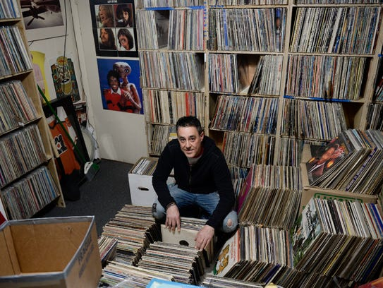 Owner Dave Frankel surrounded by records in the backroom