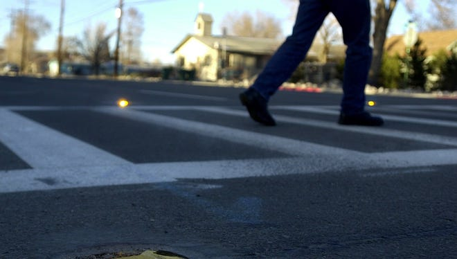 A file photo of a pedestrian crossing on a crosswalk. U.S. Sen. Catherine Cortez Masto introduced new legislation to expand federal funding to safety programs that cover high school students who chose to walk or bike to school.