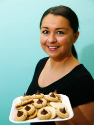 LoKie Treats' owner and baker, Keisha Sebuharara holds