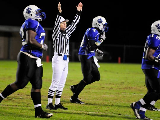 A referee signals a Godby touchdown.