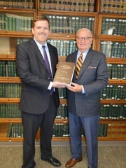 Professor Ottinger presents Brian C. Flanagan with a personal copy of the Treatise.