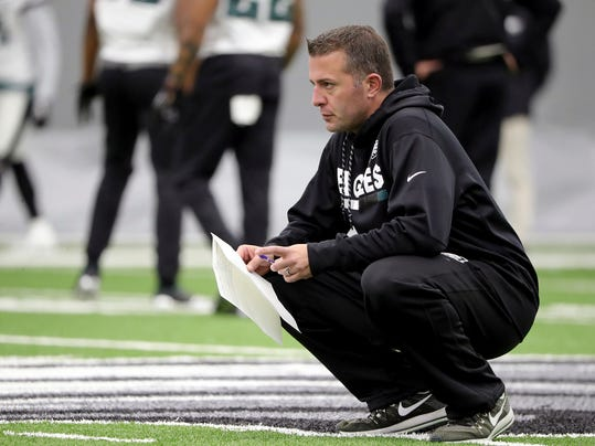 In this Jan. 3, 2018, photo, Philadelphia Eagles quarterbacks coach John DeFilippo watches the team practice in Philadelphia, Pa. The Minnesota Vikings have hired Philadelphia Eagles quarterbacks coach John DeFilippo as their offensive coordinator. DeFilippo replaces Pat Shurmur, who became head coach of the New York Giants. The deal was done Friday, Feb. 9, 2018. (David Maialetti/The Philadelphia Inquirer via AP)