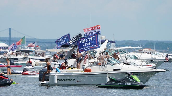 Flags supporting Donald Trump flew during last month's Aquapalooza event off Prudence Island. A pro-Trump boat parade is scheduled to begin Sunday at the Newport Bridge.