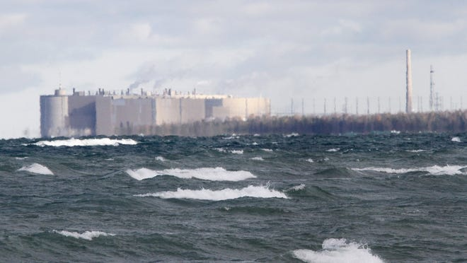 The Ontario Power Generation nuclear facility is seen from a beach off Lake Huron in Kincardine, Ontario, on Thursday, Oct. 17, 2013.