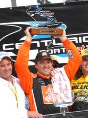 Tony Stewart celebrates his win at Watkins Glen in