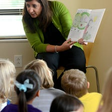 "Michelle Voizin, a Milton based author, reads her book ""A Pea with a Purpose"" to a group of kids Tuesday at the Ever'man Cooperative Grocery & Cafe Educational Center. In addition to the reading, Voizin and her daughter Laran Welser helped kids and their parents prepare a pot pie recipe that is offered in the back of the book."