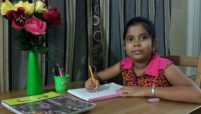 Divyasri Ranganathan, 8, won a contest writing a story book about overcoming shyness.