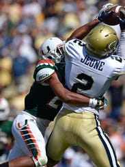 Georgia Tech wide receiver Ricky Jeune (2) tries to make a catch against Miami defensive back Corn Elder (29) during the second half of an NCAA college football game, Saturday, Oct. 1, 2016, in Atlanta. The catch was ruled incomplete. (AP Photo/Mike Stewart)