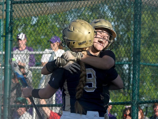 Lancaster's Alexis Matheney celebrates after scoring the game-winning run against Central Crossing during the 2017 district tournament. The Golden Gales went on to win a Division I district title and compiled a 25-5 overall record.