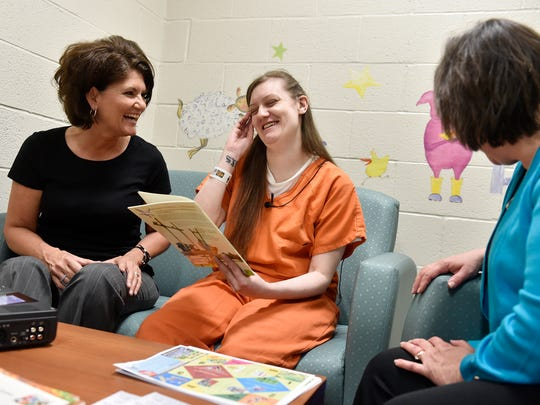 """Seated with York County Library System employees Felica Gettle, left, and Lisa Schmittle, inmate Stephanie Schymansky, center, gets ready to read a book aloud for an audio recording for her sons Lucas, 7, and Brandon, 11, on Wednesday, May 25, 2016, at the York County Prison in Springettsbury Township. The prison and the York County Library System are launching a new program, """"Beyond Our Walls,"""" that will enable inmates to record audio of them reading a book for their child. York County Commissioner Doug Hoke said the program, in which eight female inmates are currently enrolled, is designed to increase literacy for inmates' children and to reduce recidivism by facilitating familial bonds and inmates' transitions back into society. Additionally, upon release, participating inmates will receive a library card and re-entry resources. The program will be expanded to include male inmates in July."""