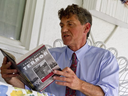 """Dr. Richard Fernicola with his book, """"The Twelve Days of Terror"""""""