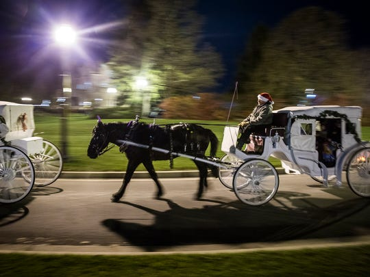 Attendees take carriage rides around Minnetrista during the Enchanted Luminaria Walk in 2016.