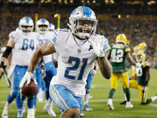 Ameer Abdullah celebrates after scoring a touchdown against the Packers last season.