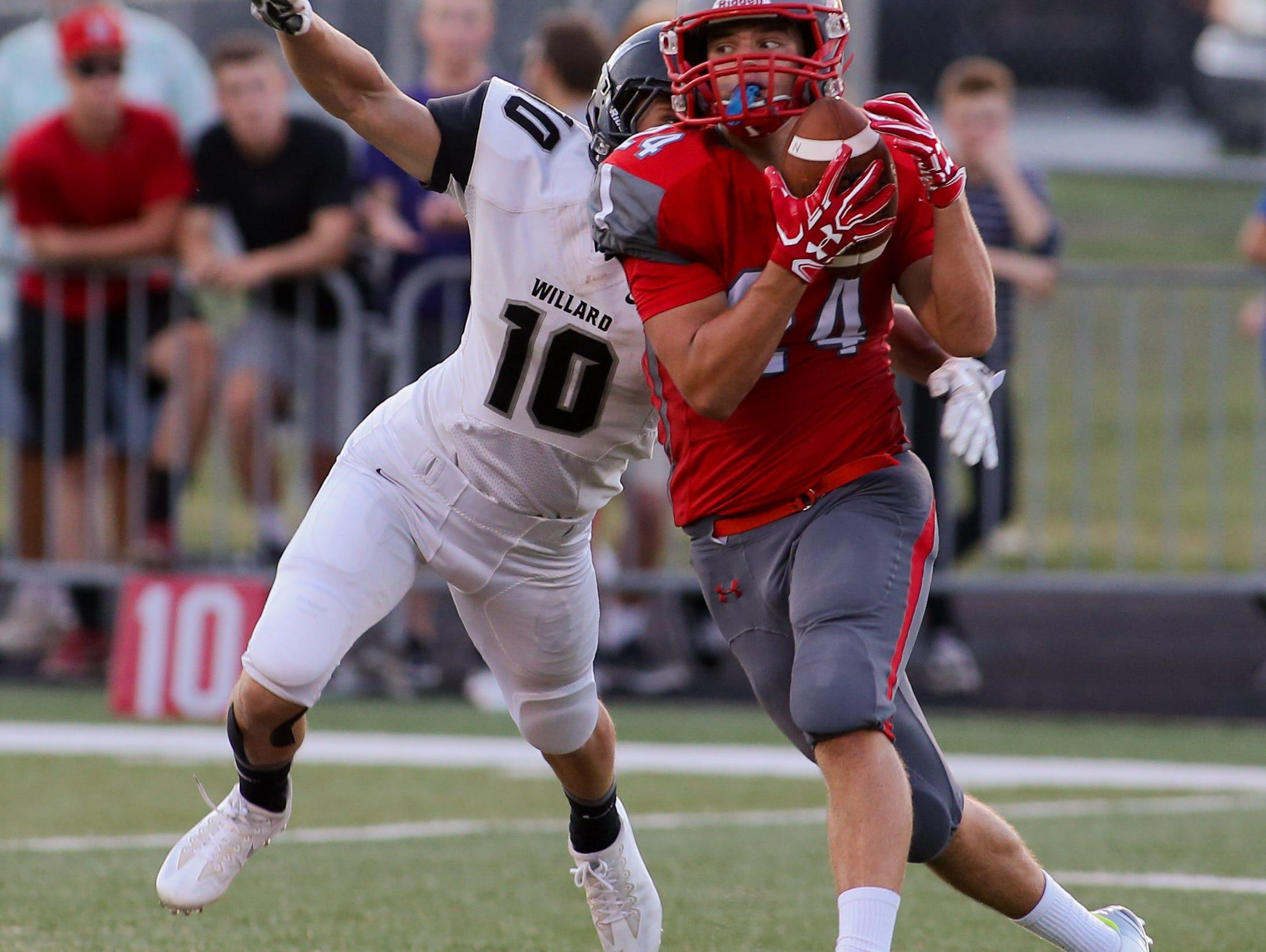 Nixa High School's Evan Deveney catches a pass against Willard High School Friday, August 19, 2016. Jason Connel / For the News-Leader