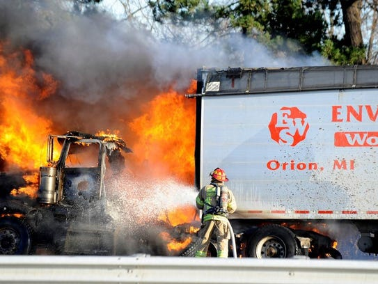 Chesterfield Twp. firefighters battle a fully-engulfed semi-truck fire on I-94 eastbound just east of 21 Mile Rd. in Chesterfield Twp., Tuesday afternoon. Authorities shut down I-94 eastbound with backups to at least Hall Road.