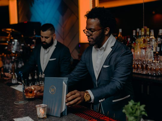 Staff prepares drinks at the Willis Show Bar.