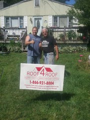 Frank Bernat and Glenn Tennelli, Roof4Roof's senior site supervisor, stand in front of Bernat's home, which received a free roof repair on July 3 courtesy of Roof4Roof.