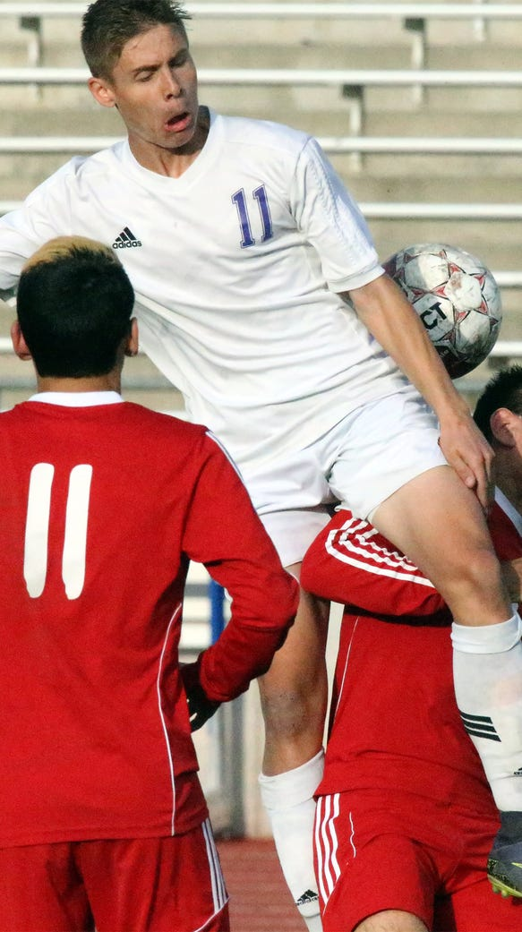 Sean Ryan, 11, of Eastlake leaps for a header against